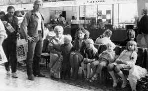 Peter and his family wait for their flight to the United States